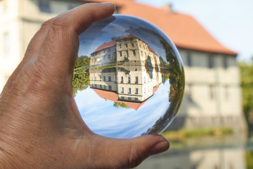 Water Castle Castle Architecture Ball Body Part Building Exterior Built Structure Close-up Crystal Ball Day Finger Focus On Foreground Galss Glass - Material Hand Holding Human Body Part Human Hand Lifestyles Magic Men Nature One Person Outdoors Real People Reflection Sphere Transparent Water Water Castle