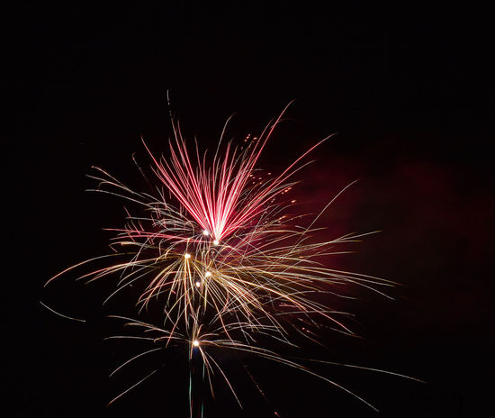 Sylvester 2017/18 Arts Culture And Entertainment Black Background Celebration Close-up Event Exploding Firework Firework - Man Made Object Firework Display Glowing Illuminated Long Exposure Low Angle View Motion Multi Colored Night No People Outdoors Sky Sparkler Sparks