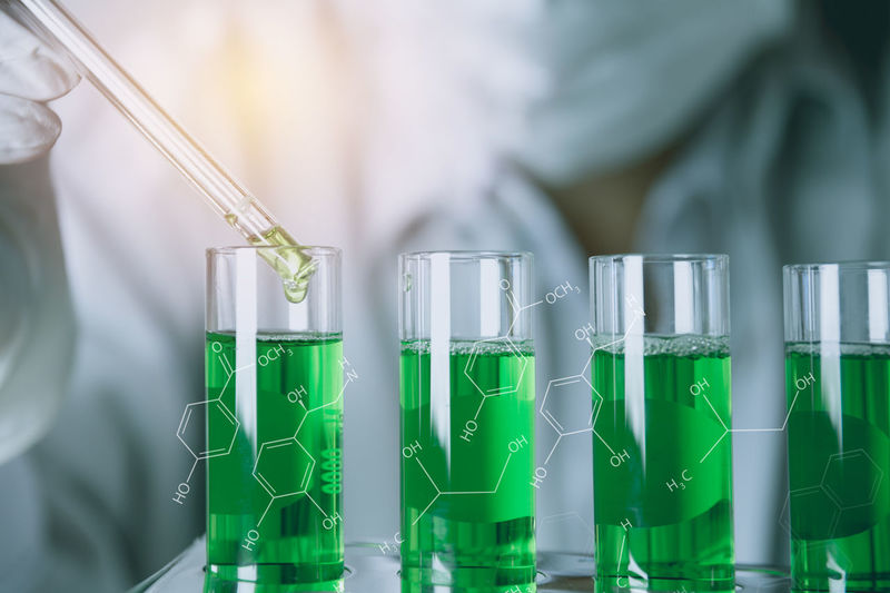 Analyzing Biochemistry Biology Biotechnology Chemical Chemistry Close-up Discovery Education Focus On Foreground Green Color Healthcare And Medicine Indoors  Lab Coat Laboratory Laboratory Glassware Medical Research Occupation Research Science Scientific Experiment Scientist Test Tube Tray