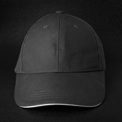 Cap on dark background Casual Fashion Hat Black Background Black Cap Cap Close-up Clothing Directly Above Folded Hats High Angle View Indoors  Jeans Leather No People Old Publication Single Object Still Life Studio Shot Sun Protection Sun Visor Textile Textured
