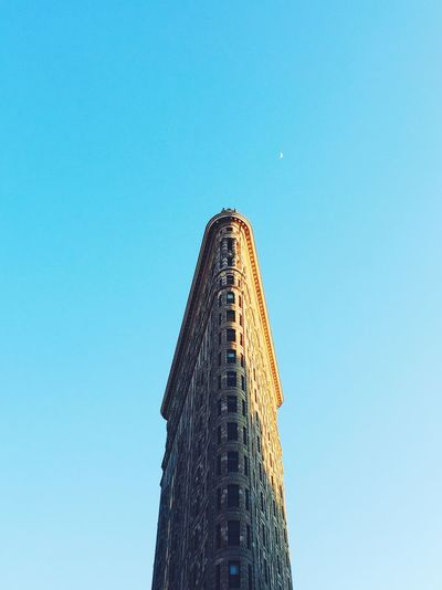 Low angle view of flatiron building against clear sky