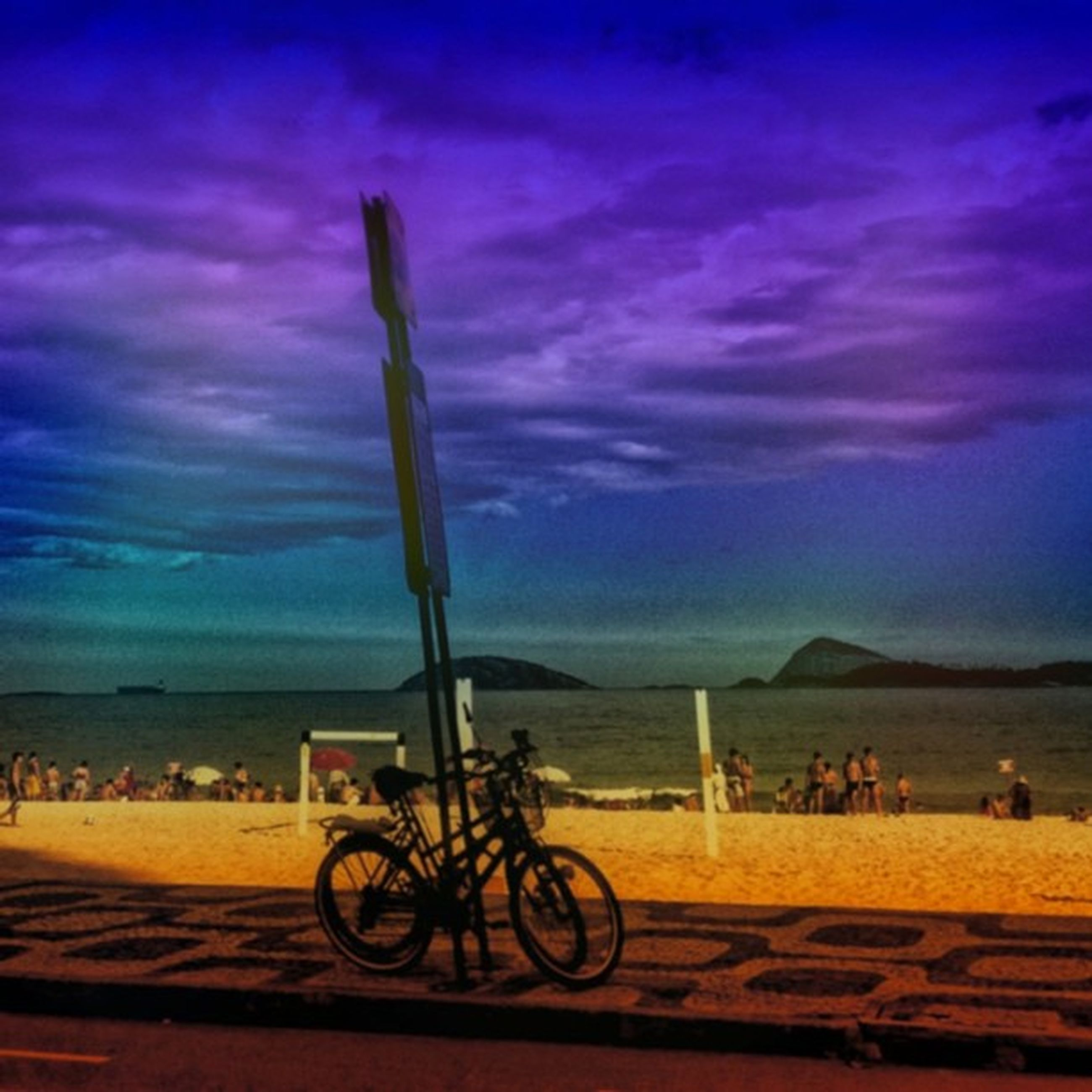 bicycle, sky, sea, beach, cloud - sky, horizon over water, scenics, water, transportation, beauty in nature, mode of transport, land vehicle, tranquil scene, shore, tranquility, sand, nature, cloud, sunset, cloudy
