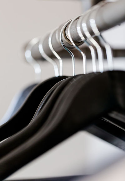 Black hangers hanged on rustic poll under shelf in wardrobe. Vertical composition with selective focus on wire, shallow depth of field Black Object Business Choice Close-up Coathanger Day Light Empty Hangers Hanging Home In A Row Indoors  Keep Clean Metal Minimalism No People Order Protection Room Selection Shirts Still Life Wardrobe Wire