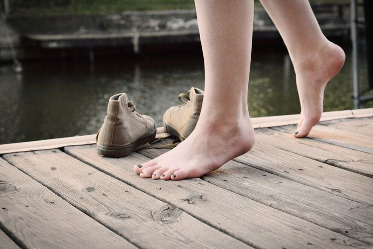 Low Section Barefoot Human Leg Human Body Part One Person Human Foot Pier Day Outdoors Childhood Children Only Close-up People Adult Summer Dock No Shoes Feet Lake Shoes EyeEmNewHere Sommergefühle