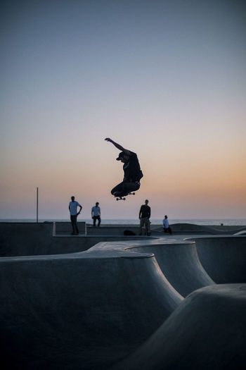 Sunset skate sessions at the Venice Beach skate park. Sunset Real People Men Sky Portrait Silhouette Jumping Sport Concrete Outdoors Gradient California Skateboard Skate Park Pacific West Coast Stunt Skill  Lifestyles Mid-air Group Of People Leisure Activity EyeEm Gallery People Full Length