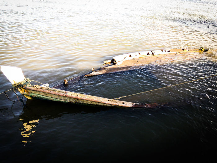 High angle view of shipwreck sinking in sea