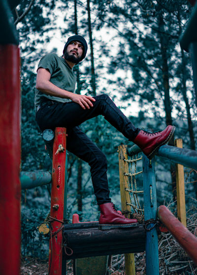 Young man dressing in a casual and rebellious way in an abandoned playground
