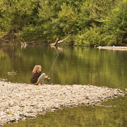 Boy fishing from shore. Russian River. Boy Fishing Reflection Water Fishing Nature Camping Children Outdoors Rocks Stillness Fishing Rod Rod Russian River Campinglife One Person