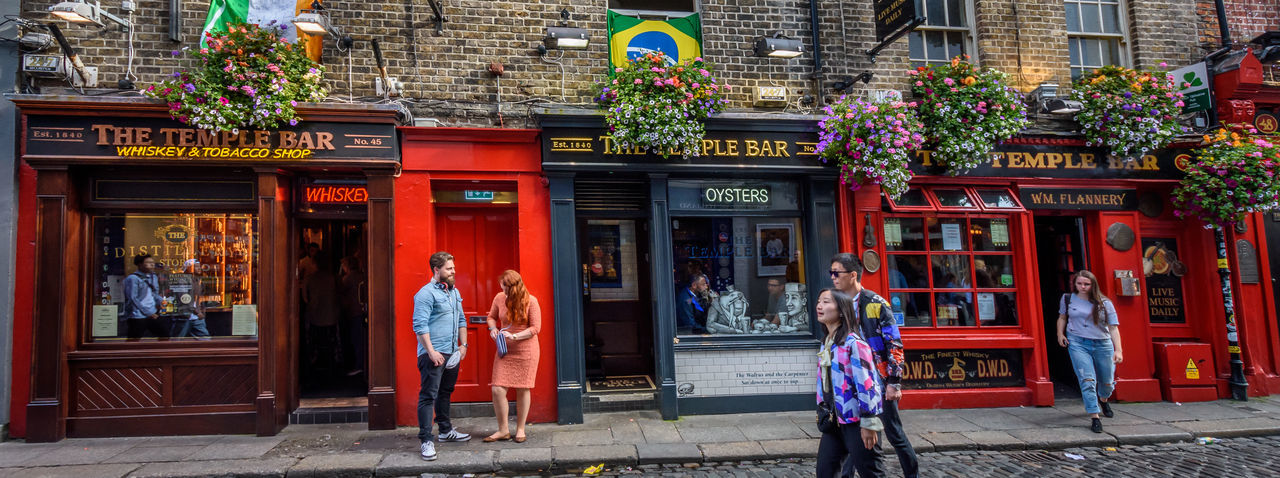 Adult Adults Only Architecture Building Exterior Built Structure Business Finance And Industry City City Street Craftsperson Cultures Dublin Entrance Full Length History Ireland Outdoors People Pub Red Street Tourism Tourist Tranquility Travel Travel Destinations