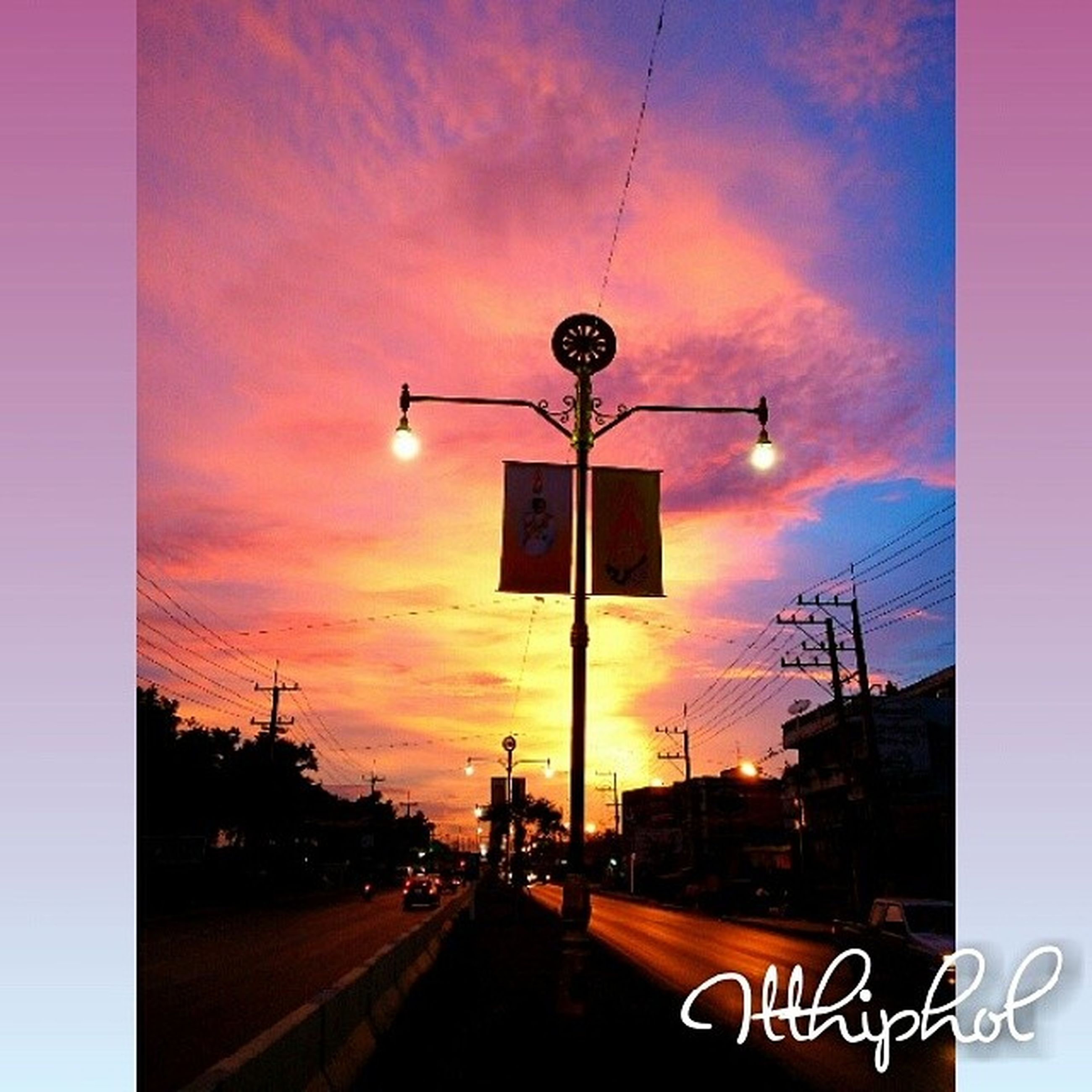 street light, sunset, sky, lighting equipment, building exterior, transportation, architecture, built structure, road sign, illuminated, street, communication, orange color, road, cloud - sky, low angle view, car, guidance, information sign, the way forward