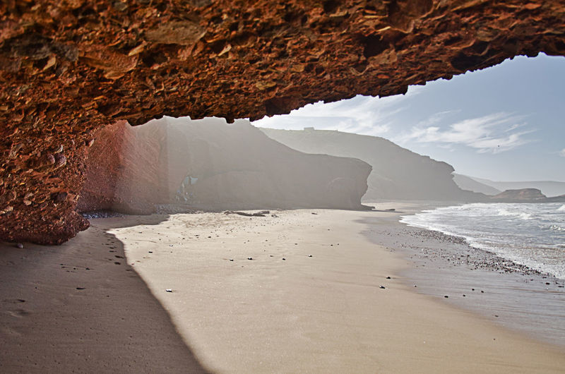 Sea Water Land Rock Formation Nature Beauty In Nature No People Rock Beach Tranquility Day Rock - Object Sand Sky Scenics - Nature Tranquil Scene Outdoors Solid Arch Eroded