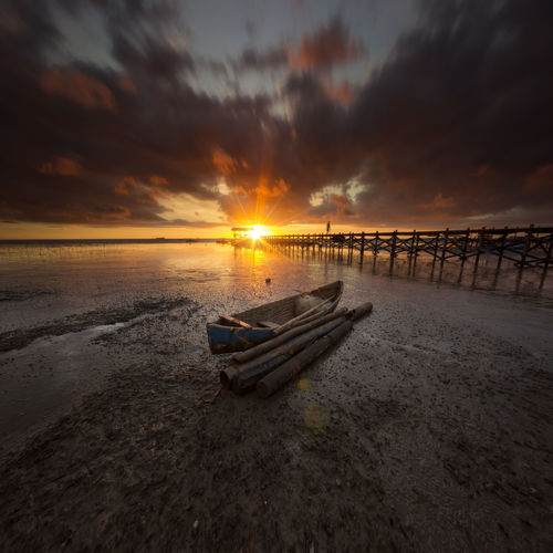 Low tide Longexposure Long Exposure Sunset Beach Sea Cloud - Sky Water Nautical Vessel Sky Dramatic Sky Sun Horizon Over Water Nature Beauty In Nature Sunlight Transportation Tranquility