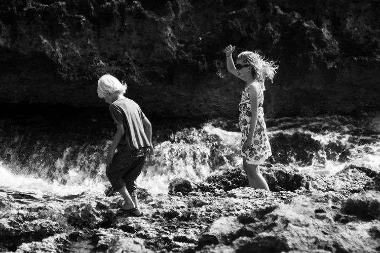 Kids Mallorca Rock Rock Formation Rocky Coastline Wave Youth Blackandwhite Boy Brother & Sister Childhood Cliff Girl Rocks And Water Summer Summer Vibes Togetherness Two People Walking Water Waves And Rocks Wind Young And Free Be. Ready. Canon Summer Exploratorium