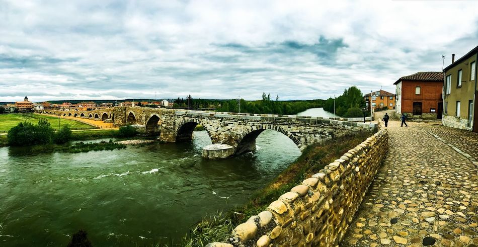Arch Arch Bridge Architecture Bridge Bridge - Man Made Structure Built Structure Canal City Cloud Cloud - Sky Cloudy Connection Day Diminishing Perspective Engineering Nature Outdoors Overcast Rippled River Sky The Way Forward Travel Destinations Walkway Water
