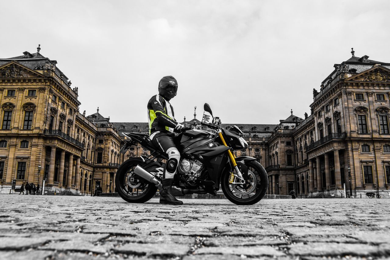 transportation, mode of transportation, building exterior, architecture, built structure, motorcycle, sky, one person, sport, real people, land vehicle, city, men, helmet, day, travel, riding, full length, street, crash helmet, outdoors, biker
