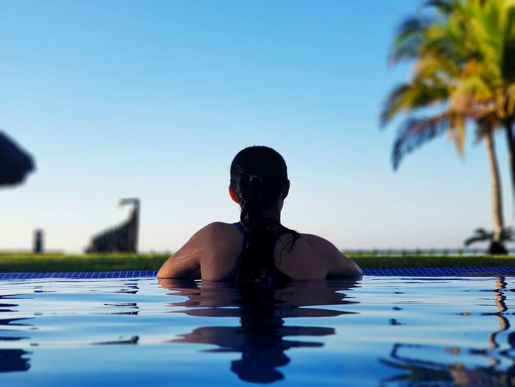 Travel time enjoying the morning swim Bigblue Summer Adults Only Reflection Only Women People Swimwear Palm Tree Travel Relaxation Refreshment An Eye For Travel Summer Exploratorium The Portraitist - 2018 EyeEm Awards The Traveler - 2018 EyeEm Awards
