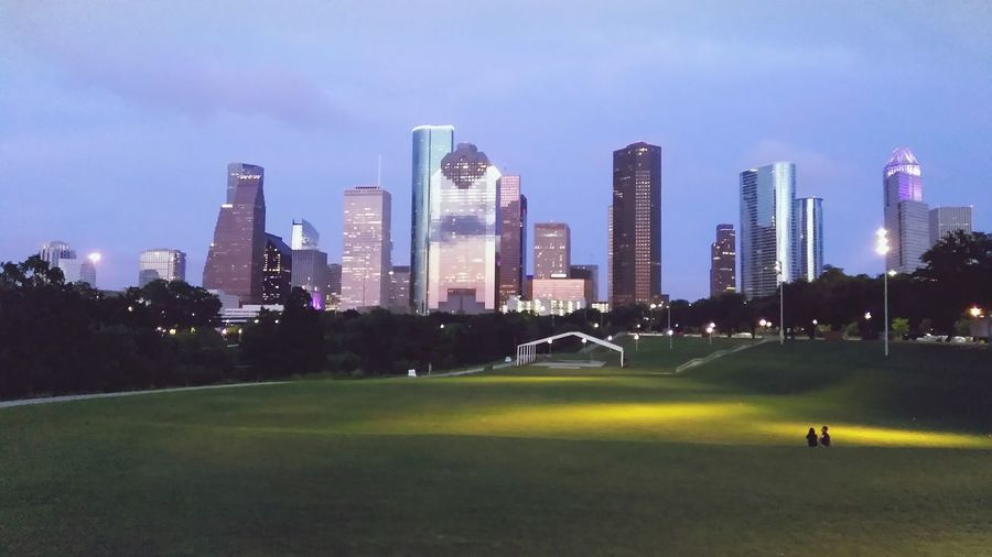 My view of downtown HoustonTX Urban Skyline Skyscraper Architecture Night Cityscape Illuminated City Building Exterior Sky Modern Outdoors No People