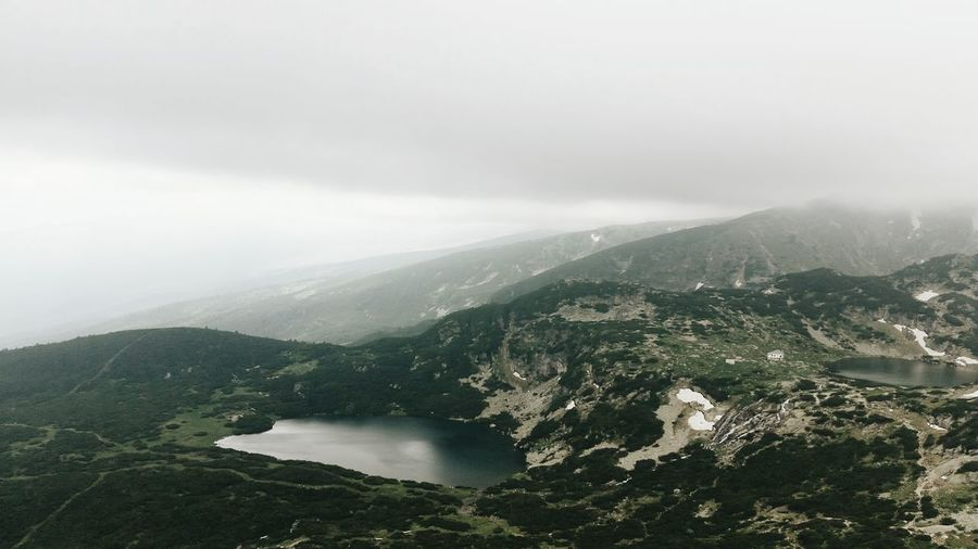 Scenic View Of Mountains Against Sky During Foggy Weather