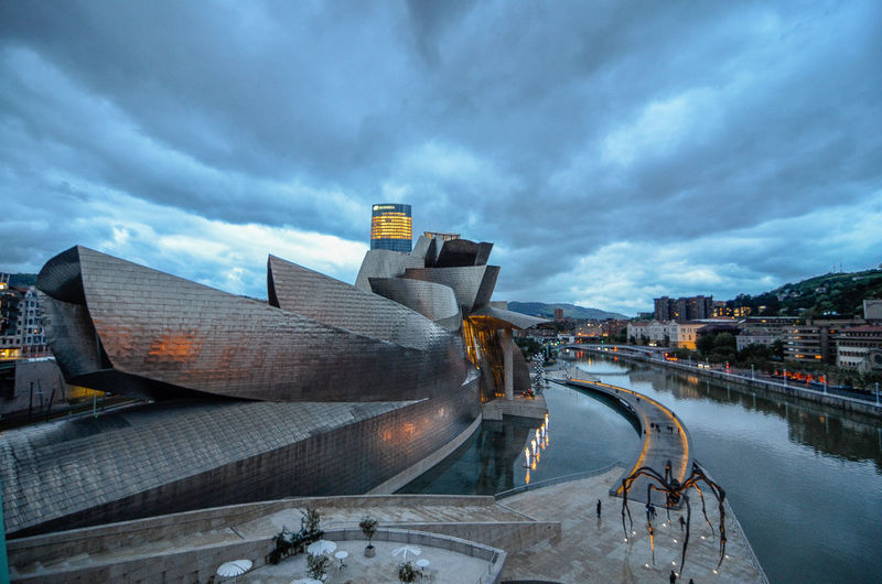 Architecture Architecture Architecture_collection Architecturelovers Building Exterior Built Structure City Cityscape Cloud - Sky Dramatic Sky Guggenheim Bilbao Illuminated Modern Museum Night No People Outdoors Sky Skyscraper Travel Destinations Urban Skyline Wild Women Photographers