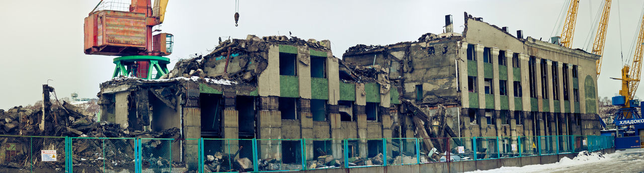 Low angle view of damaged building against sky