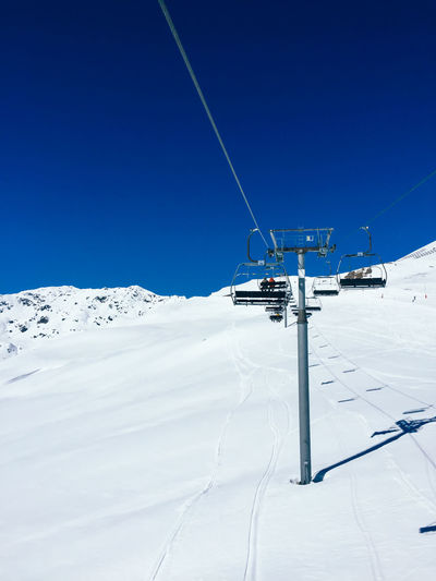Ski Lift On Snow Against Clear Sky