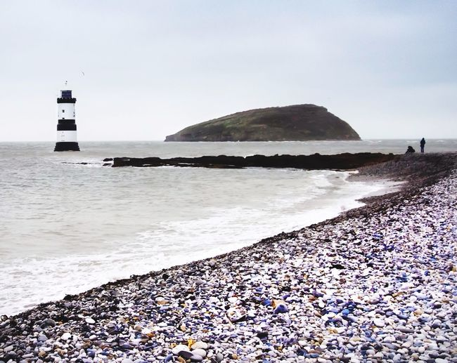Penmon lighthouse, Anglesey, North Wales. Taking Photos Showcase: December Enjoying Life Lighthouse Beachphotography Eyem Best Shots EyeEm Gallery EyeEmBestPics EyeEm Best Shots - Landscape