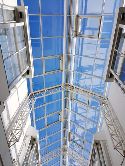 Built Structure Architecture Low Angle View Window View Windows Skylight Skylight By Design Skylight, Window, Ceiling, Roof, Light, Sky, Pattern No People Day Blue Sky Background Blue Skys Natural Daylight Symmetry Building Interior Architecture Streetphoto Shopping Street Blue Sky