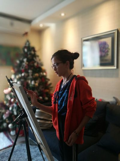 Girl painting on easel at home