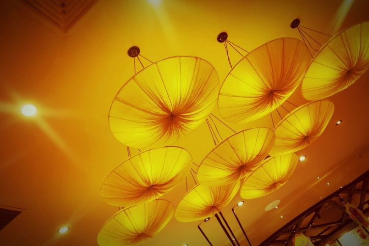 Low Angle View Ceiling Indoors  Lighting Equipment No People Illuminated Multi Colored Lantern Hanging Yellow Close-up Night Architecture Sky