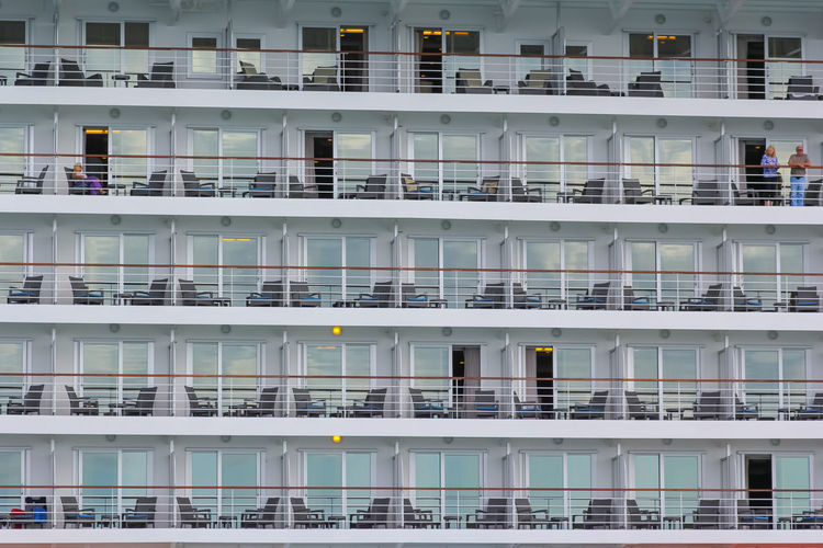 Split, Croatia - 08.16.2014: Look at the huge ferry in the port of Split and repeating pattern of rooms. Passenger Ship Room Terrace Apartment Background Balcony Big Boat Boat Built Structure Cabin Chairs Cruise Glass Huge Journey Lifeboat Launch Liner Luxury Nautical Vessel Pattern Relax Tables Tour Vacation Window