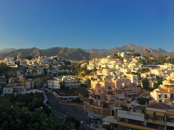 Nerja, Spain. Travel SPAIN City Cityscape Community Tree Mountain Clear Sky Residential Building High Angle View Old Town Sky TOWNSCAPE Housing Settlement Residential Structure Exterior Roof Townhouse Row House Tiled Roof  Human Settlement Country House Town Settlement Crowded Urban Skyline Roof Tile Residential District Rooftop The Great Outdoors - 2018 EyeEm Awards