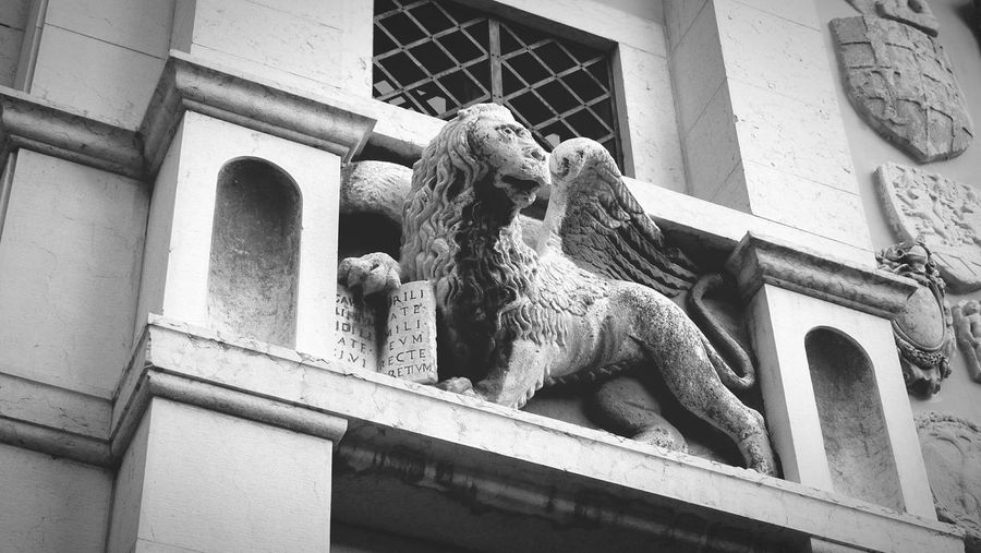 Lion of St Mark, Republic of Venice Lion Stone Ornament Low Angle View Façade Outdoors Architectural Feature No People Day Building Exterior Italy Garda Past Glory Saintmark Latin Blackandwhite EyeEm Gallery Eyeemphotography Monochrome Photography