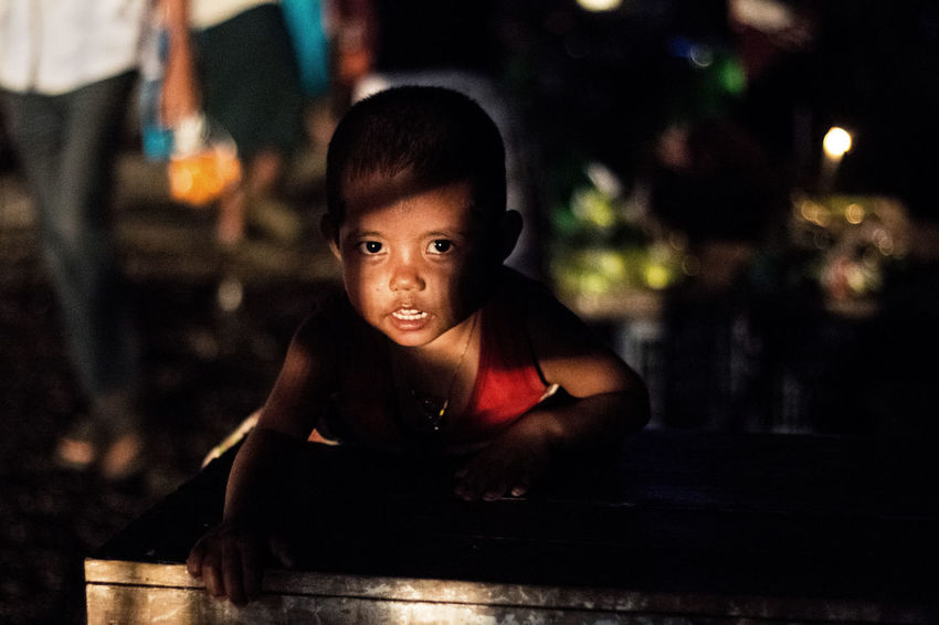 A kid on the street Creative Light And Shadow Rangoon Myanmar Street Photography