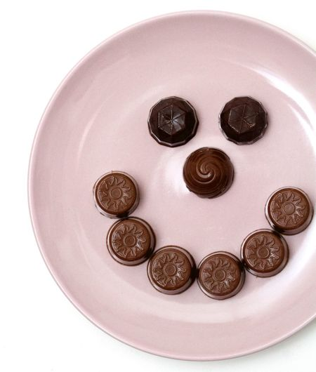 smile of chocolate truffles in a pink plate on white background Chocolate Close-up No People Pink Plate Smile Truffles White Background