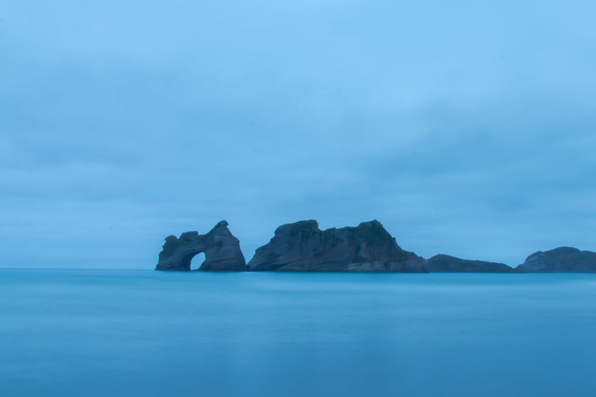 Beach Beauty In Nature Blaue Stunde Blue Blue Hour Cliff Cloud - Sky Coastline Day Horizon Over Water Landscape Langzeitbelichtung Longtimeexposure Nature New Zealand New Zealand Scenery No People Outdoors Rock Formation Scenics Sea Sky Tranquil Scene Water Wharariki