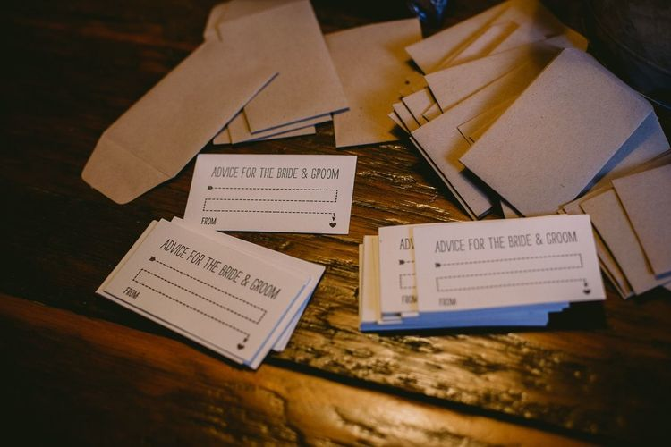 Close-up of wedding advice cards with envelopes
