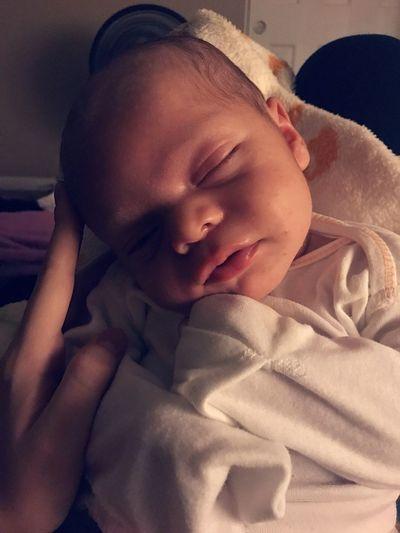Close-Up Of Baby Sleeping At Home