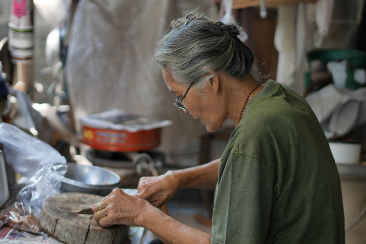 Craft Concentration Adults Only Candid One Person Working Seniors Skill  One Woman Only Only Women Adult Senior Adult Real People Working One Senior Woman Only People Indoors  Workshop Day Thailand Photos Thailand EyeEm Team