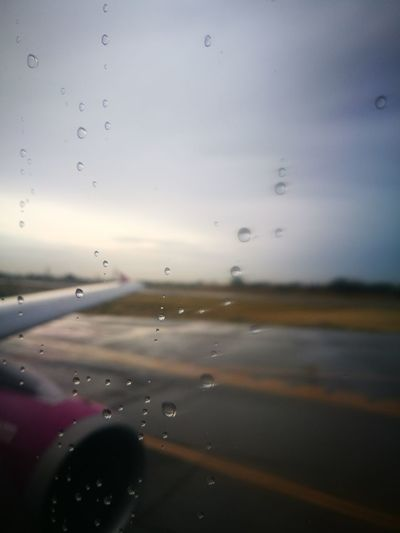 Airplane No People Sky Drop Flying Air Vehicle Wet Travel Backgrounds Cloud - Sky Water Aerospace Industry Day Close-up Rainy Days Rain The Traveler - 2018 EyeEm Awards