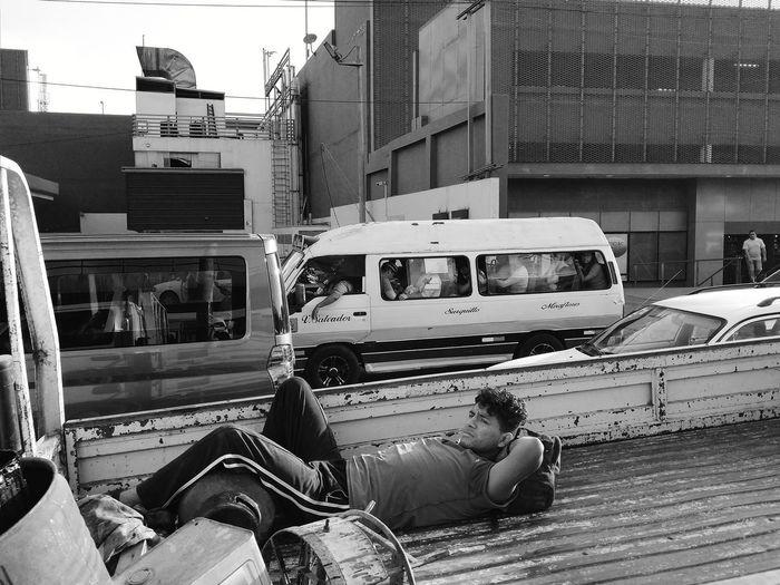 People sleeping on street in city
