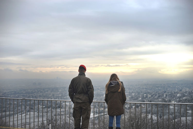 """""""We will always find our way back home"""". Lovers overlooking the city of Vienna in Christmas eve. Adult Adults Only Cold Temperature Day Only Men Outdoors People Rear View Sea Sky Togetherness Two People Warm Clothing Winter Young Adult Traveling Home For The Holidays Your Ticket To Europe"""