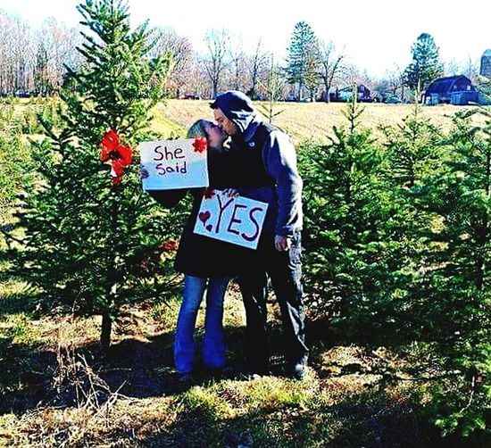 romance, love, Two People Outdoors Togetherness Christmas tree Christmastime Engagement Photos Engaged Happy, joy Future Husband Future Wife