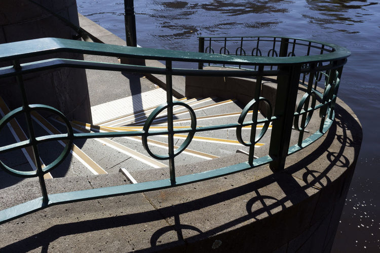 Water Shadow Sunlight Railing Nature Day High Angle View Transportation No People Sea Bicycle Metal Outdoors Architecture Absence Seat Wheel Stairs River Riverbank