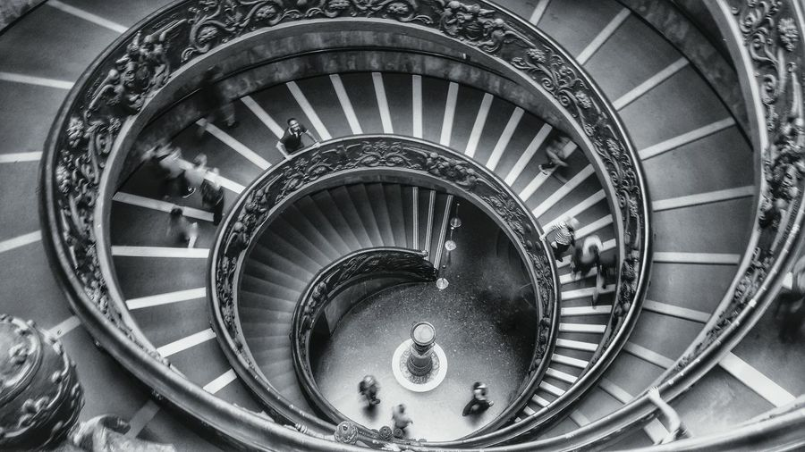 Blurred Motion Of People Walking On Spiral Staircases At Vatican Museums