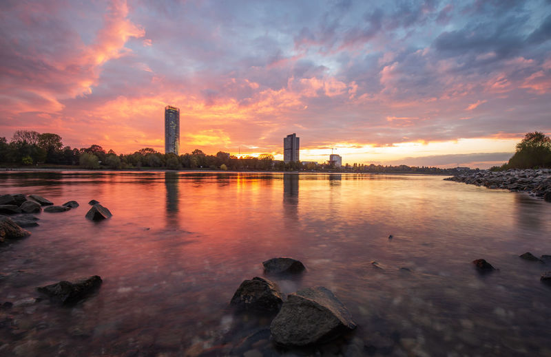 The River Rhine and the the city of Bonn, Germany, at a colourful sunset Sky Sunset Cloud - Sky Water Architecture Nature Reflection Skyscraper No People Bonn Germany Rhine Rhine River Rhine Valley Rhein Rheinufer Tourism