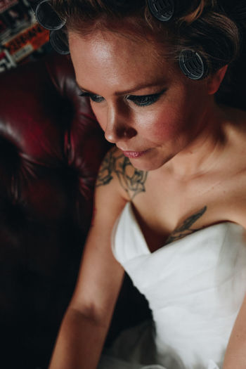 Close-up of bride sitting at home