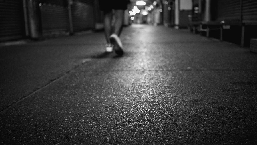 Man walking on street at night