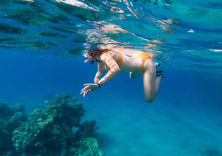 Woman snorkeling in sea