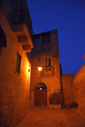 Low angle view of historic building against sky at night