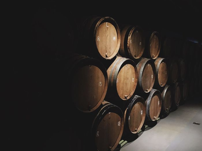 Low Light Vintage Barrels Of Wine Barrels EyeEm Selects Cellar Wine Cask Wine Cellar Winery Barrel Wine Winemaking In A Row Indoors  Alcohol Food And Drink Wood - Material Keg No People